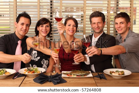 friends in a restaurant cheers clink glasses food
