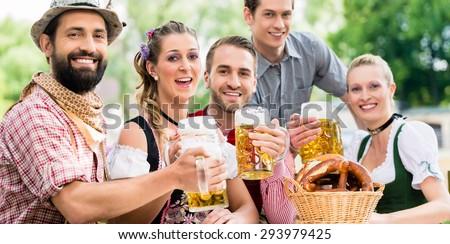 Friends in Bavarian beer garden drinking in summer ストックフォト ©