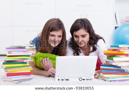 Friends in college together - beautiful girls study with books and laptop