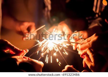 Friends lit sparklers #695323486