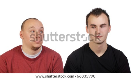 Friends looking at each other questioning each other. - stock photo