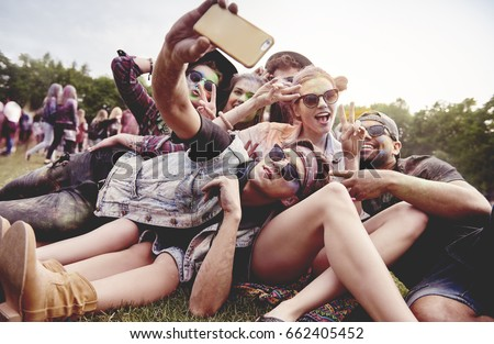 Friends making selfie at the summer festival #662405452