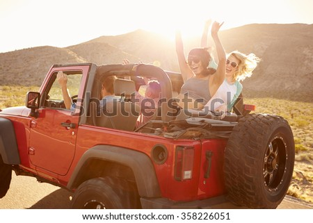 Friends On Road Trip Driving In Convertible Car #358226051