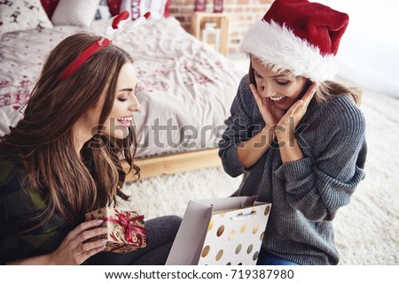 Friends opening a christmas present