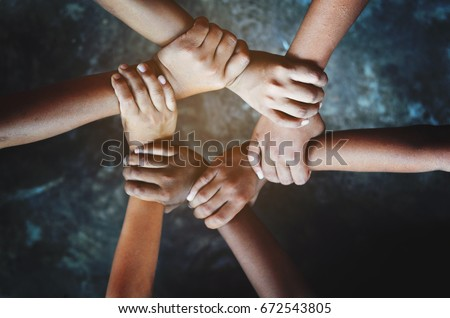 Friends putting their hands together. , Close up