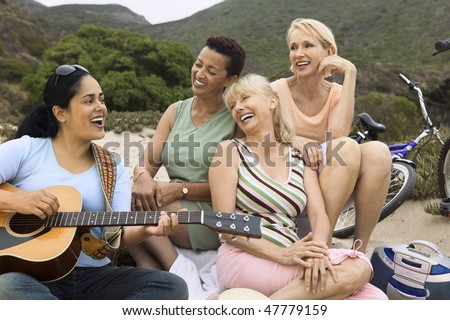 Friends singing and playing guitar