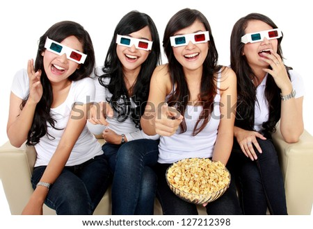 friends sitting on couch laughing at comedy movie in 3d