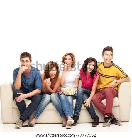 friends sitting on couch laughing hard at comedy movie