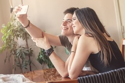 Friends taking a selfie, a woman and a man, young people