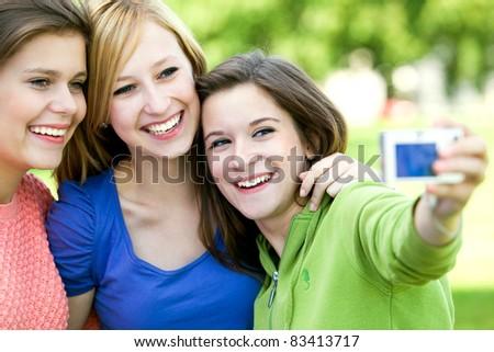 Friends taking photo - stock photo