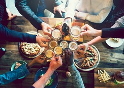 Friends toasting with craft beer