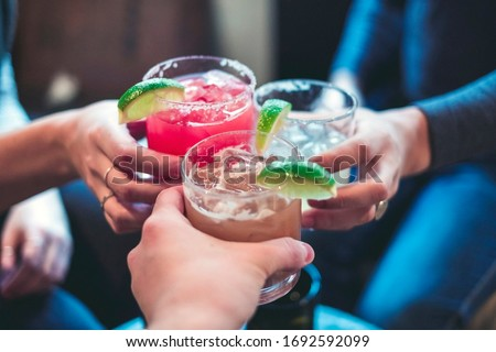 Friends toasting with margaritas and tropical drinks.  Cheers! Photo stock ©