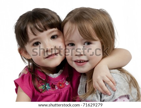 Friends - Two Adorable little girls isolated on white background
