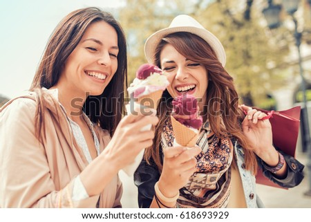 Friends, two women,with shopping bags in the city.Sale,consumerism and people concept.