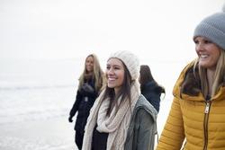 Friends walking along a Beach having fun