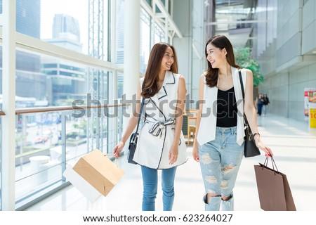 Friends walking in shopping mall