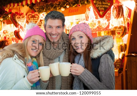 friends warmin up on german christkindl markt