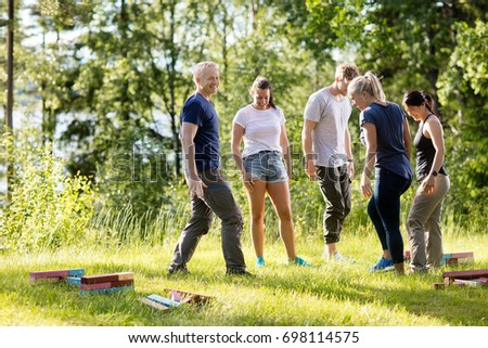 Friends With Building Blocks On Grassy Field In Forest