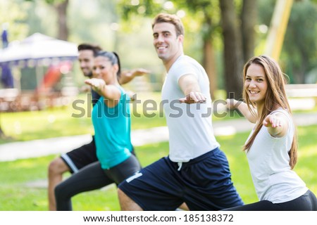 Friends work out in park. Selective focus