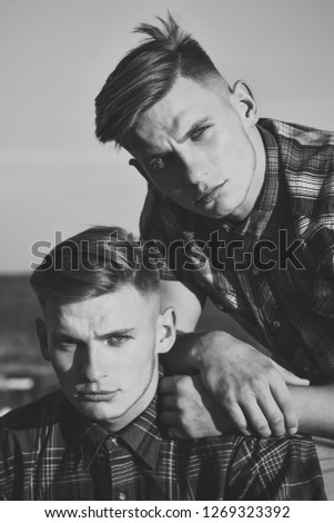 friendship and relations. friendship of twin men in sunrise. #1269323392