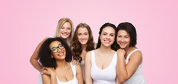friendship, beauty, body positive and people concept - group of different happy women in white underwear over pink background
