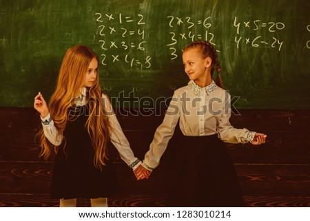 friendship. friendship of two school girls. friendship concept. friendship relations of little girls in school. work hard play hard #1283010214