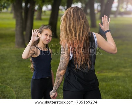 Friendship of all ages. Confidence in family life. Teenage happiness, joyful mood. Mother care , motherhood , sport teamwork, joy concept #735169294