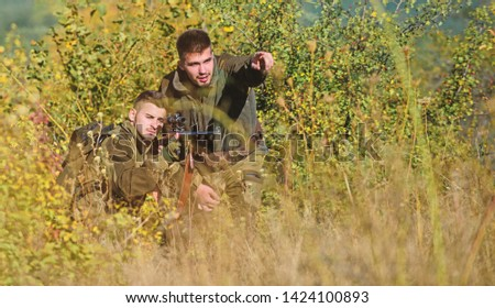 Friendship of men hunters. Man hunters with rifle gun. Boot camp. Military uniform fashion. Army forces. Camouflage. Hunting skills and weapon equipment. How turn hunting into hobby. green peace.
