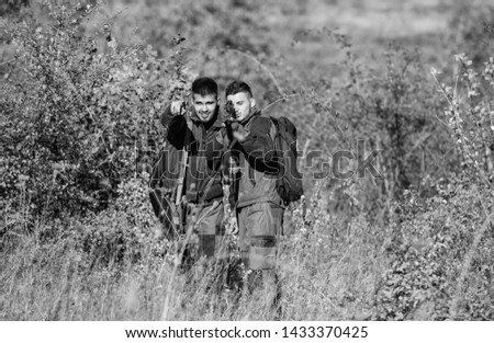 Friendship of men hunters. Man hunters with rifle gun. Boot camp. Military uniform fashion. Army forces. Camouflage. Hunting skills and weapon equipment. How turn hunting into hobby. best friends.