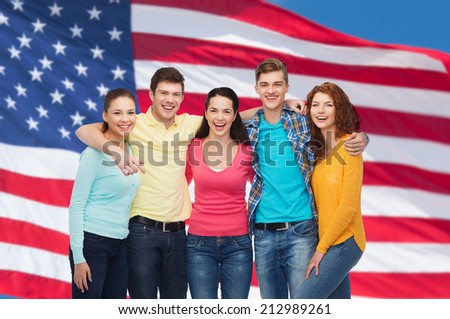 friendship, patriotism and people concept - group of smiling teenagers standing over american flag background