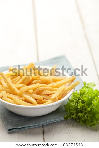 fries and fresh salad leaves
