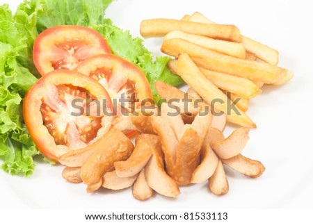 Fries sausage with French fries and vegetables on white background