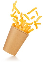 fries spilling out of a take-out paper cup tilted on white background