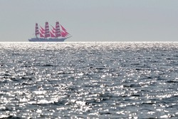 Frigate with scarlet sails in the sea