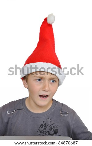 Frightened adorable child with Santa Hat - stock photo