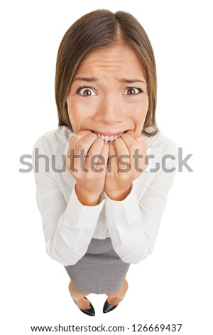 Shutterstock Frightened and stressed young business woman biting her fingers, high angle