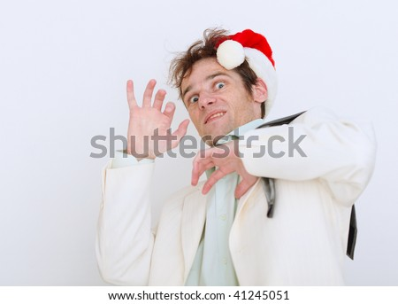Frightened by approach of new year the person on a white background