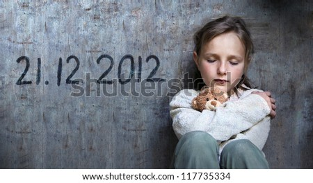 Frightened child with date of end of the world.