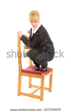 frightened young woman on the chair, full length, white background