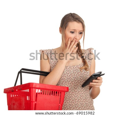 frightened young woman with red basket checking purchases list