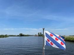 Frisian flag on a boat around Warten in Friesland the Netherlands