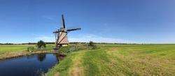 Frisian landscape panorama with windmill around Nijemirdum, Friesland The Netherlands