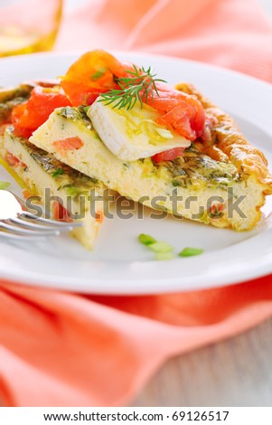 Frittata with salmon and camembert on white plate