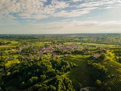 Friuli Venezia Giulia typical landscape, Udine province, Italian countryside from drone, aerial shot, vineyards hills