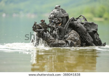 Frogman with complete diving gear and weapons in the water