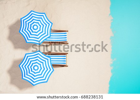 From above shot of striped chairs under umbrellas on beach. #688238131
