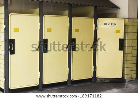 """From an old Swedish industrial plant. Toilets, one of them is reserved for women, """"dam rum"""", ladies room ! #189171182"""