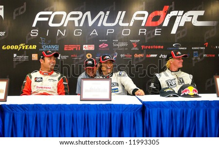 """From left, Tengku Djan, Ryuji Miki, and """"Mad"""" Mike Whiddet, at the press conference at the end of the inaugural Formula Drift Singapore 2008 event April 27, 2008 in Singapore."""