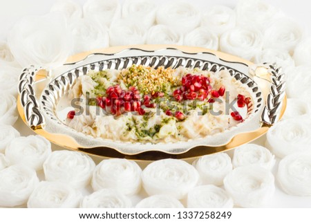 From Ottoman cuisine to Turkish cuisine a traditional dessert Gullac,in stylish,shiny metal,tray on handmade paper roses.Luxury and special design.