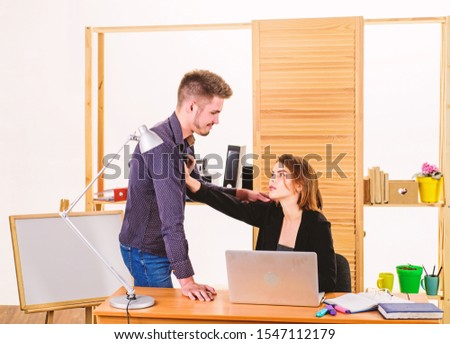 From platonic friendship into romantic love. Romantic couple conducting workplace affair. Boss and secretary having romantic relationship. Romantic partnership of bearded man and sexy woman in office. #1547112179